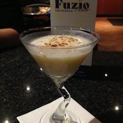 Photo taken at Fuzio Universal Bistro by Ashley on 11/24/2012