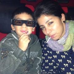 Photo taken at Omniplex Cinema by Mey C. on 10/28/2012