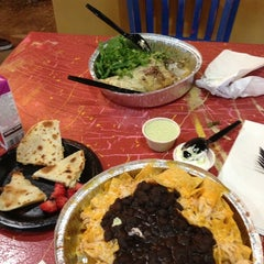 Photo taken at Cafe Rio Mexican Grill by Eneyda B. on 4/5/2013