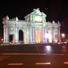 Photo taken at Puerta de Alcalá by Bryan P. on 10/7/2012