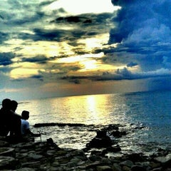 Photo taken at Pantai Senggigi by nikhen T. on 12/17/2012