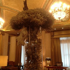 Photo taken at The Westin Palace Milan by Carlo V. on 12/18/2012