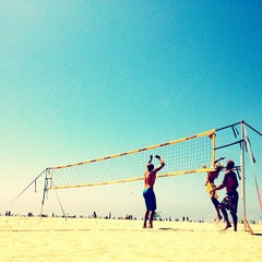 Photo taken at Huntington Beach Beach Volleyball Courts by Matthew T. on 4/21/2013
