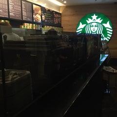 Photo taken at Starbucks by Sasha S. on 6/11/2015