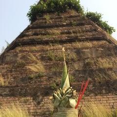Photo taken at That Dam Stupa by LihHoe I. on 4/3/2014