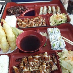 Photo taken at Sushi Dragon by Elizabeth C. on 9/17/2013