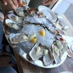 Photo taken at Henlopen City Oyster House by Ed G. on 4/2/2012