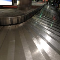 Photo taken at Baggage Claim by Nick B. on 5/19/2012