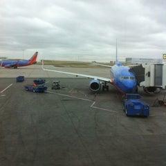 Photo taken at Gate C28 by Eric K. on 4/2/2012