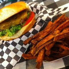 Photo taken at Wholly Cow Burgers by R Brent L. on 8/5/2012