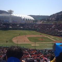 Photo taken at 사직야구장 (Sajik Baseball Stadium) by Sun Yeab S. on 4/7/2012
