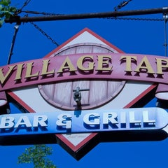 Photo taken at Village Tap by Village Tap on 7/17/2014