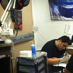 Photo taken at Afterdark Tattoos by Eva M. on 1/5/2013