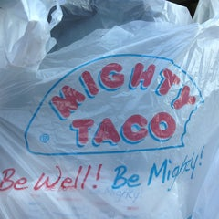 Photo taken at Mighty Taco by Susan P. on 10/2/2013