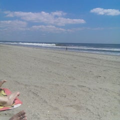 Photo taken at Rockaway Beach by Lea L. on 9/3/2014