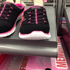 Photo taken at SKECHERS Factory Outlet by Alexa D. on 8/25/2014