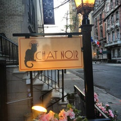 Photo taken at Bistro Chat Noir by John L. on 4/15/2012