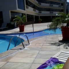 Photo taken at Piscina do Hotel Nacional Inn by Ericka C. on 3/14/2014