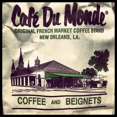 Photo taken at Café du Monde by Sam F. on 7/13/2013