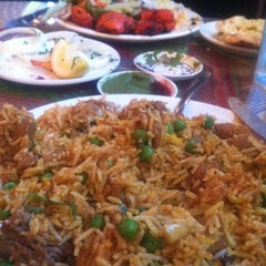 Photo taken at Taste of India by Victoria F. on 5/18/2013