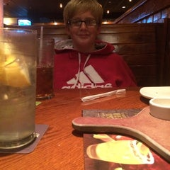 Photo taken at Outback Steakhouse by samantha p. on 10/22/2014