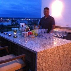 Photo taken at Nima Bay Bar & Lounge by Chufo R. on 1/1/2013