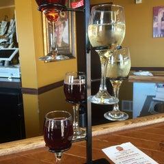 Photo taken at Vinomondo Wine Bar & Brew Pub by christine s. on 8/12/2015