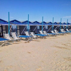 Photo taken at Spiaggia Degli Alberoni by Carlo B. on 8/18/2015