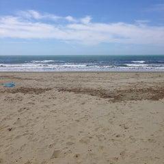 Photo taken at Lido Beach Spiaggia Libera Lido Di Camaiore by Ilaria G. on 5/1/2014