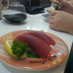 Photo taken at Sushi Train by Erica W. on 3/7/2012