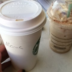 Photo taken at Starbucks Coffee by Giuliana O. on 8/22/2012