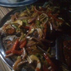 Photo taken at NADZE - NADZE TILAPIA JOINT. MADINA by Kweku O. on 3/11/2012