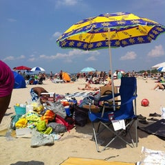 Photo taken at Wasaga Beach by Flo K. on 7/15/2012