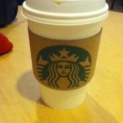 Photo taken at Starbucks by Marina G. on 1/27/2012
