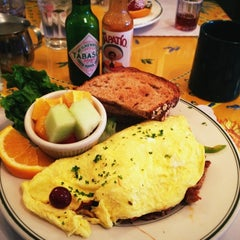 Photo taken at Mama's on Washington Square by Ron P. on 5/2/2012