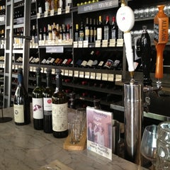 Photo taken at Buzz Wine Beer Shop by Gabriel on 7/8/2012
