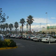 Photo taken at Mall Plaza Oeste by Juan F. on 2/18/2012