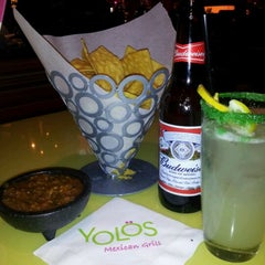 Photo taken at Yolös Mexican Grill by Kelli M. on 1/7/2012