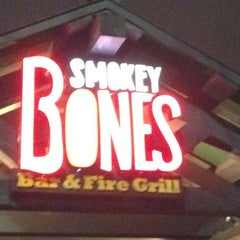 Photo taken at Smokey Bones Bar & Fire Grill by Eric S. on 2/25/2012