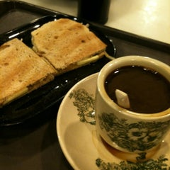 Photo taken at Wang Cafe by Jon D. on 3/25/2012