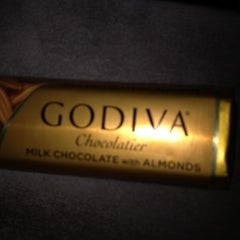 Photo taken at Godiva Chocolatier by Neville E. on 1/25/2012