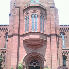 Photo taken at Smithsonian Institution Building (The Castle) by Ivan A. on 7/26/2012