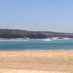Photo taken at Praia de Vila Nova de Milfontes by Innekepoes on 7/23/2012