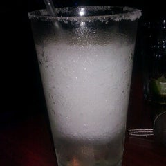 Photo taken at Bluto's Sports Grill by Fiona R. on 8/3/2012