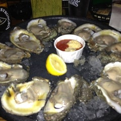 Photo taken at Fontaine's Oyster House by Mckenzie R. on 8/8/2012