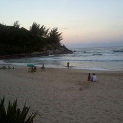 Photo taken at Praia da Ferrugem by João Pedro B. on 2/12/2012