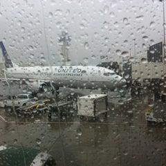 Photo taken at Gate 67B by Lucretia P. on 11/6/2011