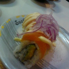 Photo taken at Sushi Train by Aaron P. on 4/1/2012