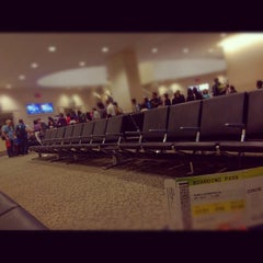 Photo taken at Gate G101 by Johnny W. on 6/11/2012