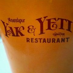 Photo taken at Yak & Yeti Local Foods Cafe by John M. on 3/19/2012